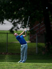 Castle's Austin Bratton drives off the 13th fairway during the SIAC Boys Golf Tournament at Helfrich Hills Golf Course in Evansville Friday morning. Bratton shot a 78.