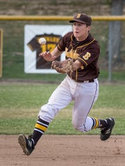 Golden West's Payton Allen fields a hit ball from Lemoore's