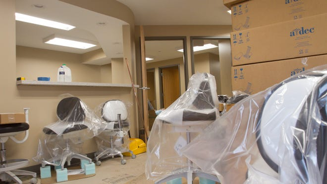 Construction on the reception area of Livingston Dental Center is near completion.