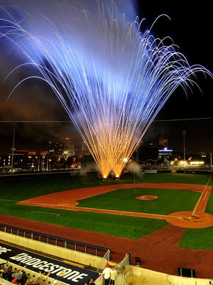 Fireworks explode from the baseball field after the Nashville Sounds' inaugural game on April 17, 2015.