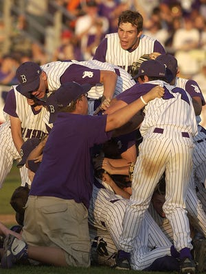 FILE – The Brownsburg Bulldogs celebrate their 2005 4A State Championship and a perfect 35-0 season at Loeb Stadium in Lafayette.