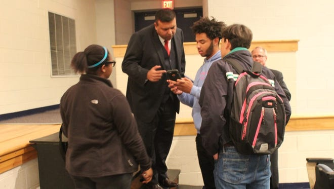Asher Gulab speaks with Sussex Central students at his induction into the Sussex Central Hall of Fame on Nov. 18,2016.