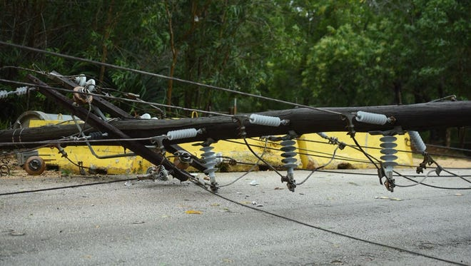 Route 17, also known as Cross Island Road, closed due to fallen utility poles and the attached power lines encroaching onto the roadway.