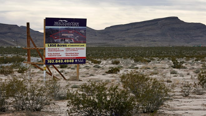 A sign advertises Mountain View Industrial Park near Apex Industrial Park on Wednesday, Dec. 9, 2015, in North Las Vegas, Nev. Chinese-backed electric carmaker Faraday Future plans to build a manufacturing plant near the site