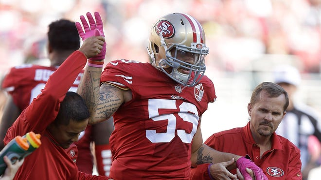 San Francisco 49ers linebacker Aaron Lynch (59) is helped off the field during the second half of an NFL football game against the Tampa Bay Buccaneers in Santa Clara, Calif., Sunday, Oct. 23, 2016.