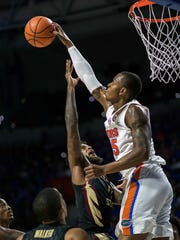 FILE - In this Monday, Dec. 4, 2017, file photo, Florida forward Keith Stone, right, blocks the shot of Florida State forward Phil Cofer during the first half of an NCAA college basketball game in Gainesville, Fla. Improved balance has created the possibility of a more unpredictable race for the title as the Southeastern Conference gets ready to begin league competition. Traditional powers Kentucky and Florida haven't fared as well as usual in nonconference play, while the rest of the league has stepped up its performance. (AP Photo/Ron Irby, File)