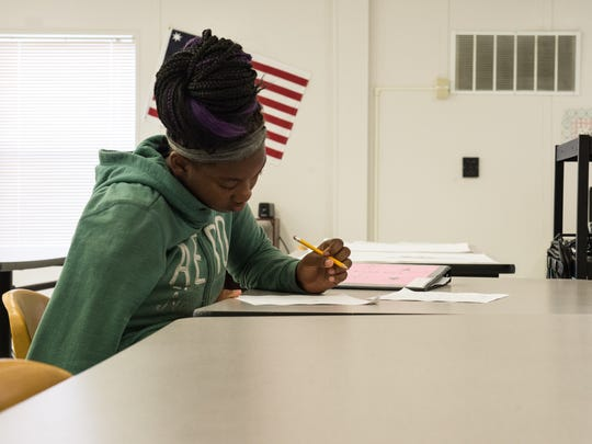 Za'Kurrie Ashanti works on a history project at Choices Academy on Tuesday, Sept. 19, 2017.