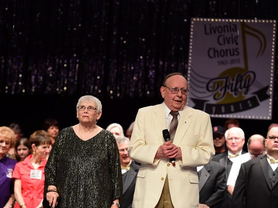 """Livonia Civic Chorus president Peggy Gaskill and the first musical director Robert Slusarski, as he tells the audience, """"Hats off to the choir that proceeded us."""""""