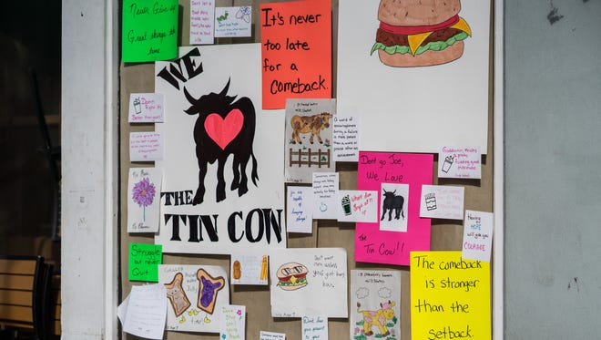 Tin Cow patrons left signs of support on the restaurant's windows after it voluntarily closed for renovations following poor health inspections.