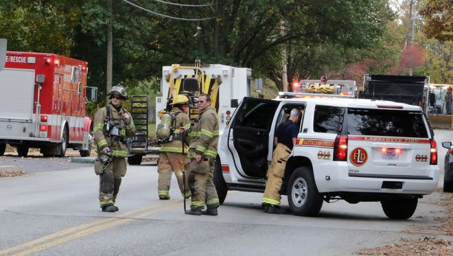 Emergency crews block South Street in Lafayette after a gas leak was reported, Friday, Oct. 20, 2015. Several homes in the area were evacuated as a precaution.