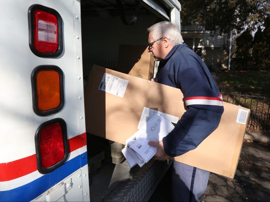 Doug Babcock delivers the mail in South Nyack for the