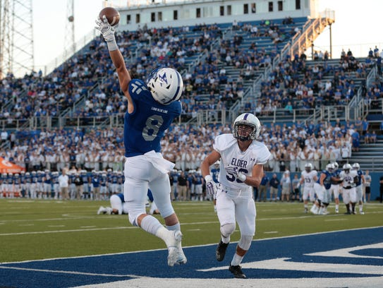 St. Xavier wide receiver Cameron Specht (8) makes a