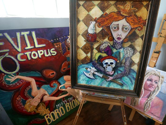 Dawna Magliacano, a local artist, shows off the varying