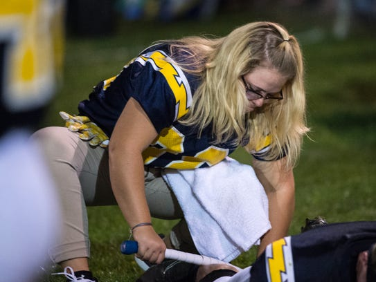 Alexis Watters, a student trainer, rolls a Littlestown
