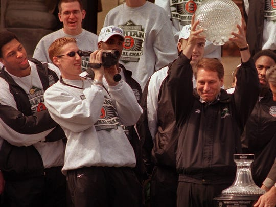 Former MSU walk-on Steve Cherry, left, videotapes the celebration in Lansing after MSU's 2000 national championship win.