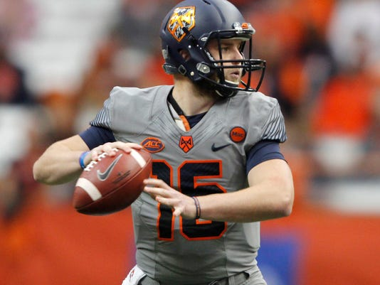 Syracuse's Zack Mahoney looks to pass the ball in the first quarter of an NCAA college football game against Wake Forest in Syracuse, N.Y., Saturday, Nov. 11, 2017. (AP Photo/Nick Lisi)