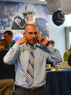 Penn State head football coach James Franklin speaks with a recruit in Lasch Football building during national signing day at Penn State.