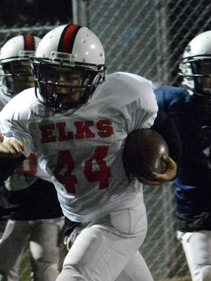 Trojans running back Ty Molina bolts through open space during Thursday's practice at Bob Forrest Youth Sports Complex.