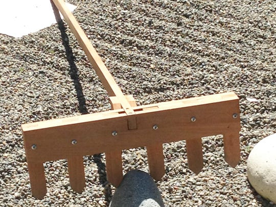 The proper rake is best made of hardwood and should have strong, wide-spaced tines.