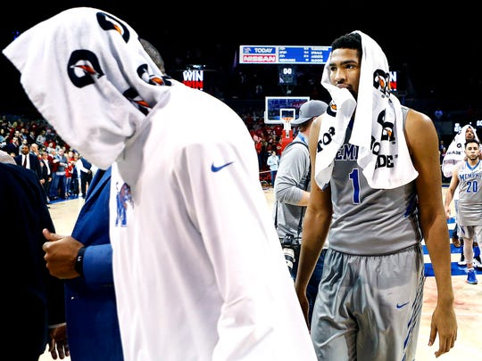 Dejected University of Memphis forward Dedric Lawson (right) walks off the court after losing to Southern Methodist University 103-62 at Moody Coliseum in Dallas on Saturday, March 4, 2017. Lawson scored 13 points off 4-12 shooting while grabbing five rebounds and allowed four turnovers in 31 minutes of play. The Tigers closed the regular season with five losses in their final six games and have a 2-6 record over the past month.