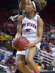 New Mexico State guard Zaire Williams goes for the