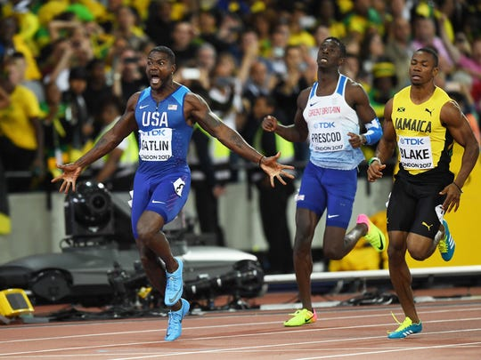 Justin Gatlin of the United States raises his arms as he crosses the line to win the Men's 100 meters final in 9.92 seconds during day two of the 16th IAAF World Athletics Championships London 2017 at The London Stadium in London, United Kingdom.