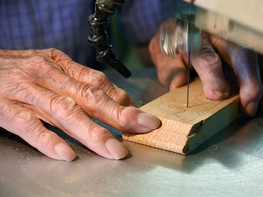 Ken Rudolph, 98, Annandale, works on the scroll saw in his wood shop Thursday, June 2, 2016, on the family farm near Annandale.
