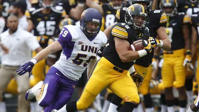 Iowa running back Mark Weisman runs back the opening kickoff against Northern Iowa. The Hawkeyes won 31-23.