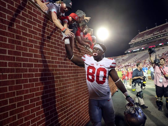 Ohio State receiver Noah Brown celebrates with fans