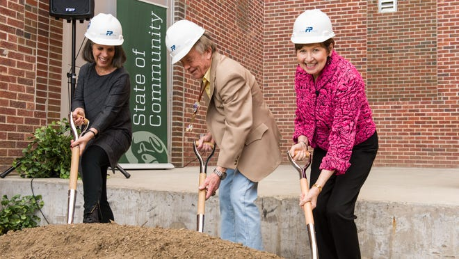 Colorado State University Art Museum director Linny Frickman, donor Torlief Tandstad and Board of Governors chair Dorothy Horrell dig in shovels to celebrate the groundbreaking for the expansion of the University Art Museum at the University Center for the Arts on March 27.
