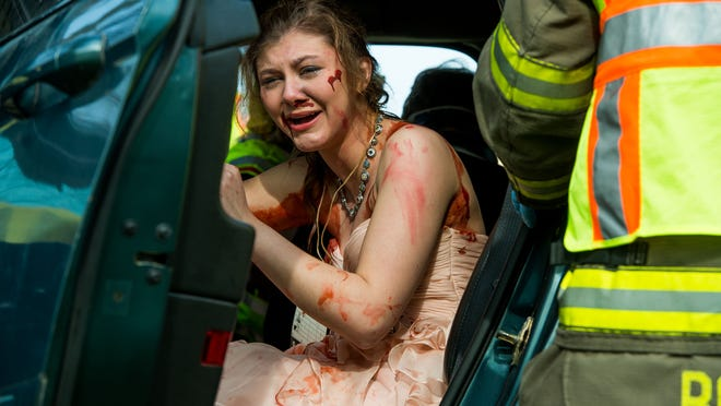 Jessica Pember, 18, cries out for help to emergency responders as she participates as one of the victims in a mock car crash held at Ripon High School on May 4.
