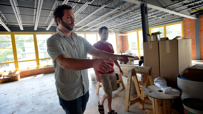 The historic Claussen Bakery building on Augusta Street is getting new tenants including Upstate Craft Beer Co. Pictured are brewery co-owners Jack McDonald and Chris Hardin.