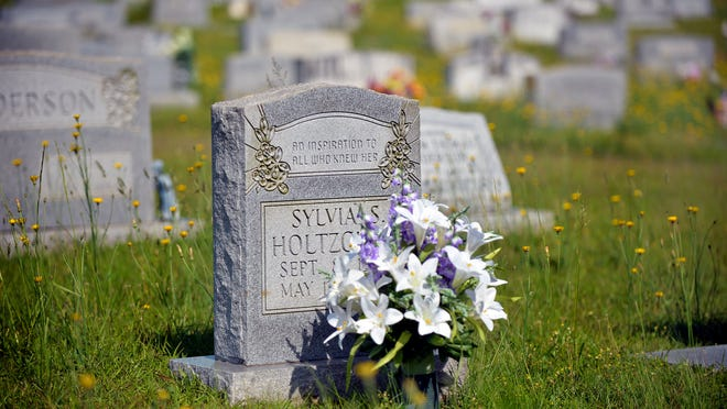 The grave site of Sylvia Holtzclaw on Wednesday, May 6, 2015. Holtzclaw was killed during a robbery at Blue Ridge Savings Bank.