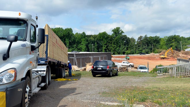 The Gospel Hour building on Pleasantburg Drive is undergoing renovation to become a Landscapers Supply and Ace Hardware.