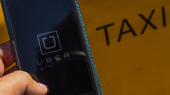 Taxi app Uber is official in Delaware after company and state officials came to an agreement on guidelines regulating the private car service.