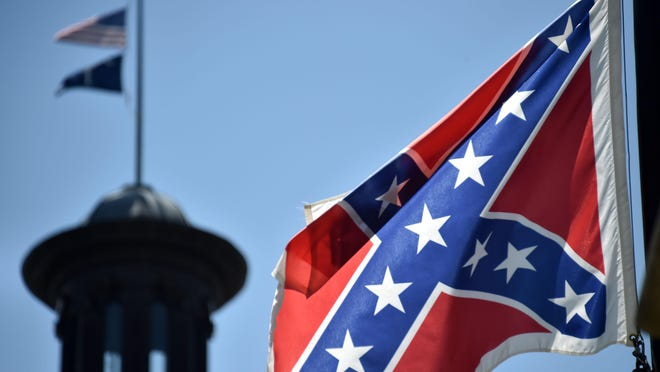 The South Carolina and American flags flying at half-staff behind the Confederate flag erected in front of the State Congress building in Columbia, South Carolina on June 19, 2015. AFP PHOTO/MLADEN ANTONOVMLADEN ANTONOV/AFP/Getty Images