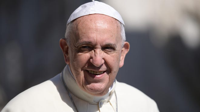 Pope Francis I greets crowds as he arrives for his weekly general audience at St. Peter's square in the Vatican on June 10.