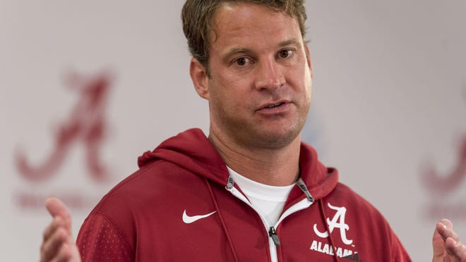 Alabama offensive coordinator Lane Kiffin talks with the media before Fan Day on Sunday, Aug. 9, 2015, in Tuscaloosa, Ala.