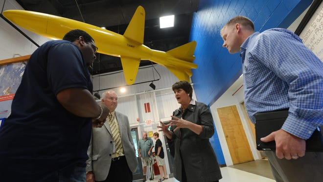 Virginia Secretary of Education Anne Holton speaks with Education Resource Center Coordinator Samuel Henry, left, at the NASA Wallops Visitor Center before a Virginia Space Flight Academy graduation on Friday, Aug. 7, 2015. Holton made several stops on the Eastern Shore to discuss education with local officials.