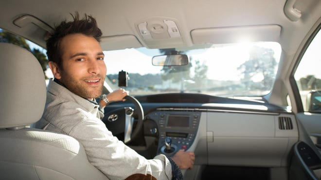 Uber drivers, like the one pictured here in this shot provided by Uber, are contractors who make their own schedules, not employees of Uber.