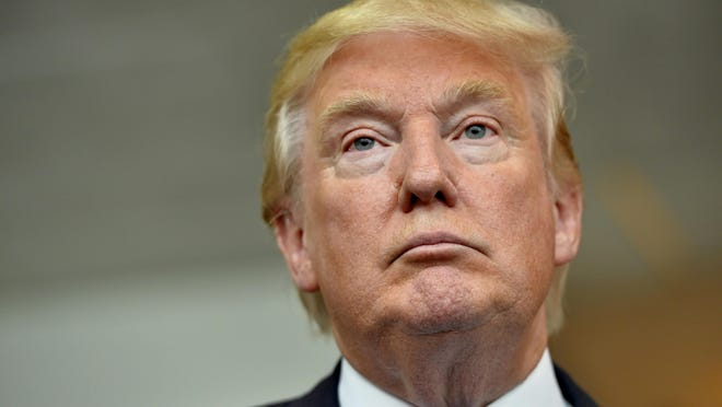 Donald Trump Republican presidential candidate Donald Trump listens during a news conference after speaking at the TD Convention Center, Thursday, Aug. 27, 2015, in Greenville, S.C. (AP Photo/Richard Shiro)