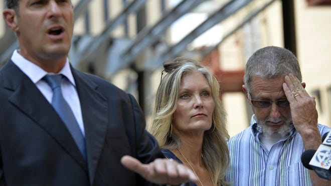Angie and Paul Hammond, parents of Zachary Hammond, pictured with attorney Eric Bland, speak during a recent press conference.