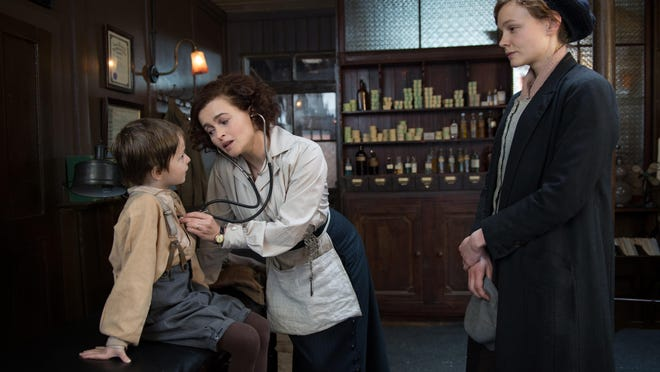 "Adam Michael Dodd, from left, Helena Bonham Carter and Carey Mulligan star in ""Suffragette."""