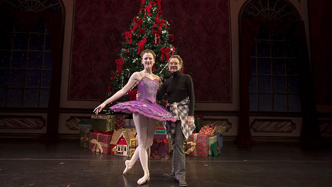 Conner Hall, who plays the Sugar Plum Fairy, and director Ann Dunn stand backstage before a rehearsal. The Asheville Ballet presents the holiday classic The Nutcracker playing Dec. 10-13 at the Diana Wortham Theatre.