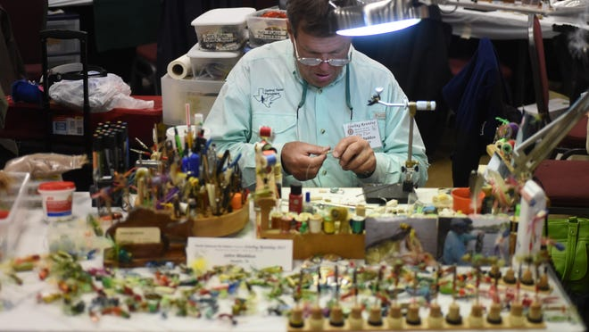 John Maddux of Hewitt, Texas works ties a fly at the 2015 Sowbug Roundup at the Baxter County Fairgrounds.
