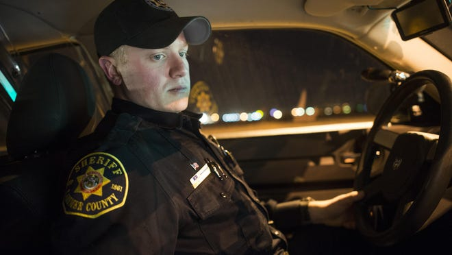 Martin Swanty, a deputy with the Larimer County Sheriff's Office, works on the computer in his cruiser while on patrol outside Fort Collins on Feb. 18. Swanty is a part of a LCSO task force in charge of keeping a watchful eye on the East Mulberry Street corridor.