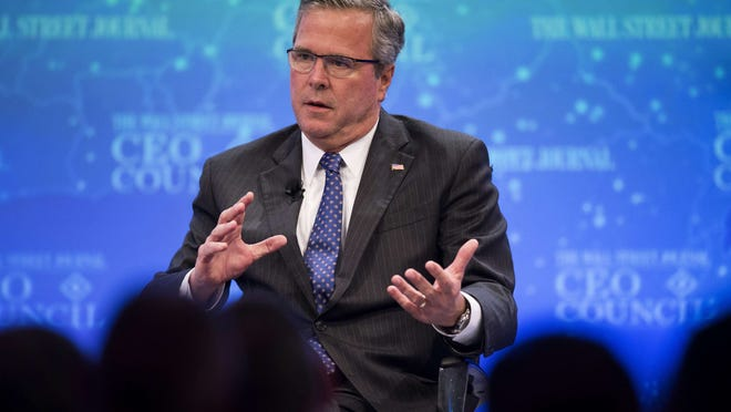 Former Florida Governor Jeb Bush speaks during the Wall Street Journal CEO Council in Washington, DC, December 1, 2014.       AFP PHOTO / Jim WATSONJIM WATSON/AFP/Getty Images ORG XMIT: 526268005 ORIG FILE ID: 535811460