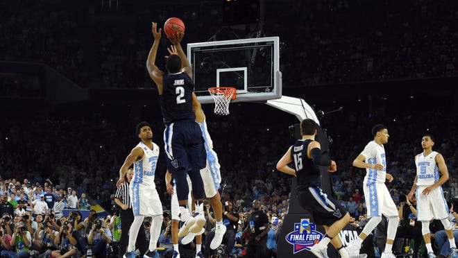 Villanova Wildcats forward Kris Jenkins (2) hits the game winning shot with .6 seconds over North Carolina Tar Heels forward Isaiah Hicks (4) on Monday in the championship game of the 2016 NCAA Men's Final Four at NRG Stadium.