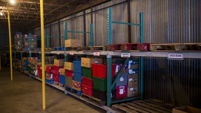 In this file photo, several shelves remain empty in the FoodNet warehouse. Summer can be an especially hard time for Acadiana families trying to make ends meet. FoodNet is accepting donations now.