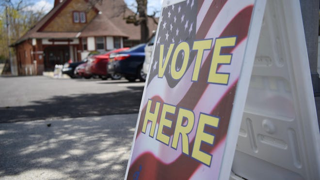 """A """"Vote Here"""" sign outside the Poughkeepsie Library in the City of Poughkeepsie during 2016 Primary."""